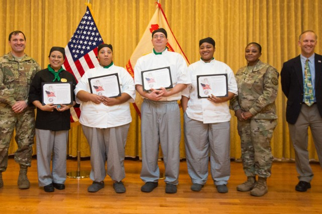 Joint Base Myer-Henderson Hall Commander Col. Patrick M. Duggan, left, presents Child Youth Services Kitchen Staff Team members -- from left -- Godchagon Leiner, Grace Parker, Ricky Tyree and Christina Benson with certificates of appreciation as Team of the 1st quarter during an awards ceremony Jan. 26. At right are JBM-HH Command Sgt. Maj. Carolyn Y. Donaldson and Chief of Staff Glenn Wait.