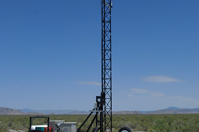 A trailer-mounted 10-meter tower, ready for its instrumentation to begin receiving data, at Dugway Proving Ground, Utah. The tower may also be folded down for travel or to work with instrumentation. The trailer also includes a Computer Network Interface for data, and a propane-fired electrical generator. A new, mobile and highly efficient system for testing chemical and biological detectors is anticipated to be complete for use this fall. Photo by Joe Mashinski, US Army