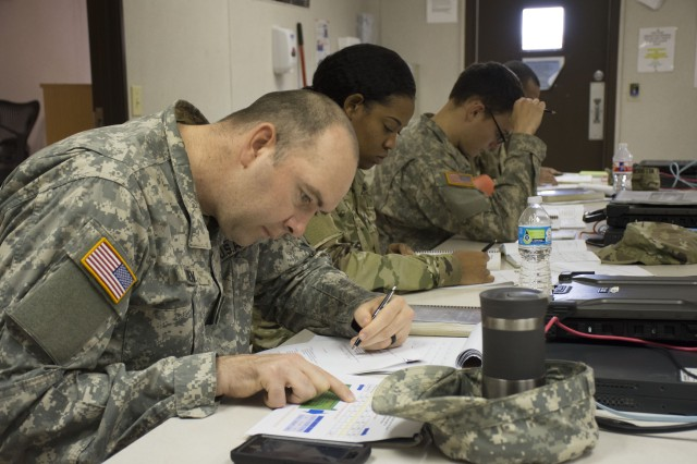 Soldiers study for their Electronics Technicians Association (ETA) Fiber certification exam. (Photo by Justin Eimers)