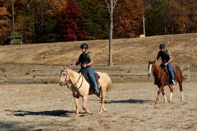 Soldiers going through the Basic Rider's Course ride horse at Caisson stables at Fort Belvoir, Va. Nov. 17, 2016