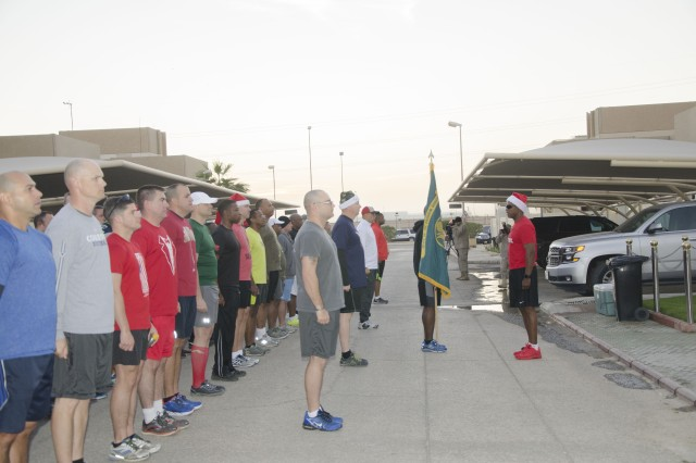 Sgt. Maj. Marc Stevenson (at front), assigned to the Office of the Program Manager for the Saudi Arabian National Guard, addresses Soldiers and civilians from various organizations at Eskan Village in Saudi Arabia Dec. 7 before a sunrise fun run.