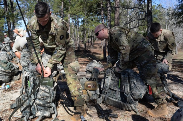 Spc. Mark Sullivan, left, with the Texas Army National Guard's Troop A, 1st Squadron, 124th Cavalry Regiment, and others on his team ready their rucksacks for the next event during training at Fort Benning, Georgia, Wednesday, Jan. 25, 2017, to be selected to represent the Army Guard in the upcoming Gainey Cup competition. Held every other year, the Gainey Cup is a demanding, mentally and physically challenging competition that tests scout teams on a variety of tactical and technical skills to determine the best scout team in the Army.