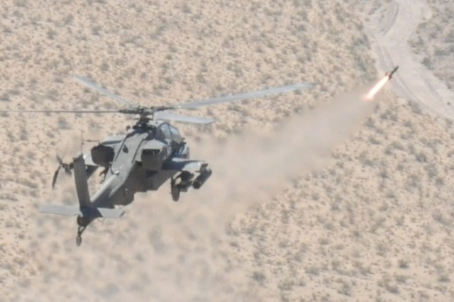 An Apache helicopter fires a Hellfire missile at Fort Irwin, California. AMCOM's Acquisition Requirement Cell provides strategic oversight of government service contracts in support of aviation and missile programs such as Apache and Hellfire.