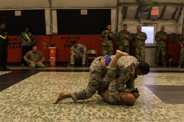Observer coach/trainers with First Army Division East contend in an Army Combatives event during the First Army Division East Best Warrior Competition at Camp Atterbury, Ind., Feb. 2, 2017. The event was the last physical hurdle of the three-day competition. (U.S. Army photo by Sgt. Jarred Woods, 157th Infantry Brigade Public Affairs)