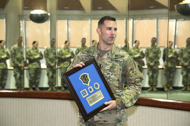 1st. Lt. Matthew Coble, executive officer, U.S. Army Intelligence and Security Command, Headquarters and Headquarters Company, speaks to the audience after receiving a farewell plaque during a ceremony at the Nolan Building, Feb 1. (U.S. Army Photo by Tani Murphy)