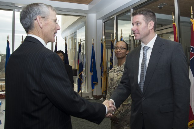 Marc Russell, engineer, U.S. Army Intelligence and Security Command, had the opportunity to meet Acting Secretary of the Army, Robert M. Speer during his visit to the Nolan building Fort Belvoir, Virginia, Feb 3.  (U.S. Army Photo by Jocelyn Broussard)