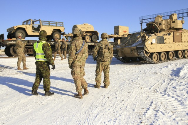 CAMP ADAZI, Latvia - Soldiers assigned to 1st Battalion, 68th Armor Regiment, 3rd Armored Brigade, 4th Infantry Division, and Estonian army movement control personnel  coordinate railhead operations in Tapa, Estonia, Feb. 6, 2017. Company C,1-68 AR joined Estonian army movement control personnel and civilian rail workers in unloading the equipment for movement to nearby Tapa Training Area. The Soldiers of 1-68 AR, based out of Fort Carson, Colo., will take over for the Paratroopers of 2nd Battalion, 503rd Infantry Regiment, 173rd Airborne Brigade, in support of Operation Atlantic Resolve, a U.S. led effort in Eastern Europe that demonstrates U.S. commitment to the collective security of NATO and dedication to enduring peace and stability in the region. (U.S. Army photo by Sgt. Lauren Harrah/Released)