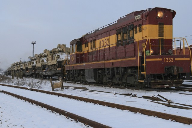 CAMP ADAZI, Latvia - A train loaded with M2A3 Bradley Fighting Vehicles and M1A2 Abrams tanks belonging to 1st Battalion, 68th Armor Regiment, 3rd Armored Brigade, 4th Infantry Division, arrived in Tapa, Estonia, Feb. 6, 2017. Soldiers of Company C,1-68 AR joined Estonian army movement control personnel and civilian rail workers in unloading the equipment for movement to nearby Tapa Training Area. The Soldiers of 1-68 AR, based out of Fort Carson, Colo., will take over for the Paratroopers of 2nd Battalion, 503rd Infantry Regiment, 173rd Airborne Brigade, in support of Operation Atlantic Resolve, a U.S. led effort in Eastern Europe that demonstrates U.S. commitment to the collective security of NATO and dedication to enduring peace and stability in the region.(U.S. Army photo by Sgt. Lauren Harrah/Released)