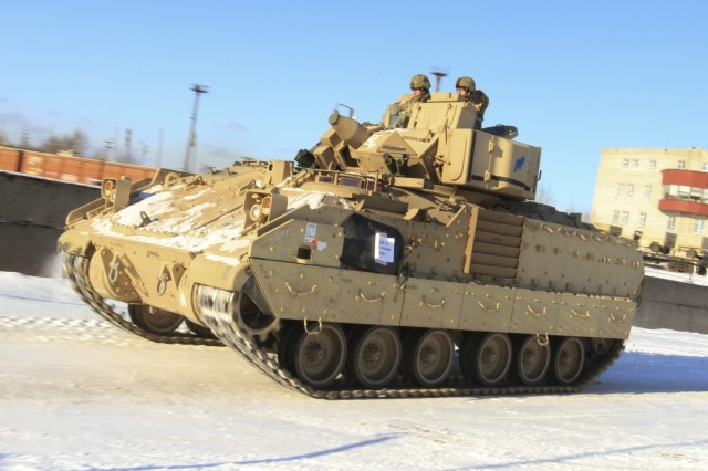 CAMP ADAZI, Latvia - Soldiers assigned to 1st Battalion, 68th Armor Regiment, 3rd Armored Brigade, 4th Infantry Division, drive an M2A3 Bradley Fighting Vehicle to Tapa Training Area following railhead operations in Tapa, Estonia, Feb. 6, 2017. The Soldiers of 1-68 AR, based out of Fort Carson, Colo., will take over for the Paratroopers of 2nd Battalion, 503rd Infantry Regiment, 173rd Airborne Brigade, in support of Operation Atlantic Resolve, a U.S. led effort in Eastern Europe that demonstrates U.S. commitment to the collective security of NATO and dedication to enduring peace and stability in the region. (U.S. Army photo by Sgt. Lauren Harrah/Released)