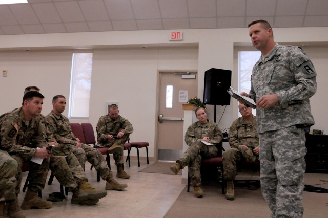 Chaplain (Maj.) Michael Hart III, senior brigade chaplain for the 120th Infantry Brigade (Multifunctional Training Brigade), First Army Division West, converses with members of the North Dakota Army National Guard's 136th Combat Support Sustainment Battalion following a mock fallen Soldier memorial ceremony at Fort Hood, Texas, Jan. 31, 2017. The unit held the practice ceremony while preparing for an upcoming overseas deployment. Rehearsing ceremonies like these helps to develop confidence and ensure proper and honorable ceremonies are conducted.