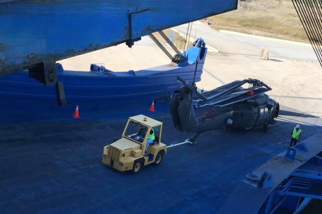 The 597th Transportation Brigade's 841st Transportation Battalion continues support of 10th Combat Aviation Brigade during vessel loading of helicopters.