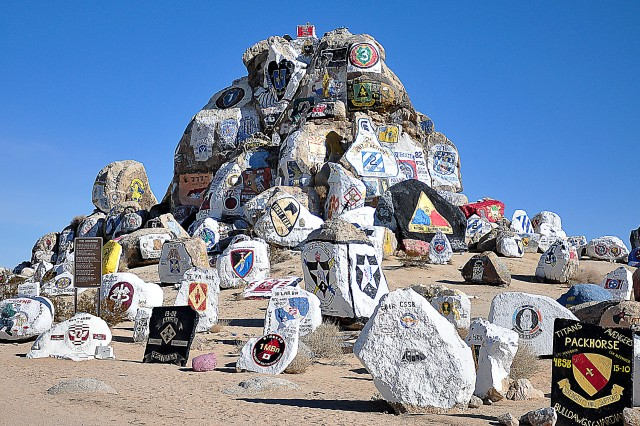 Painted rocks greet the entrance to Fort Irwin, California. Units training here have painted their crests and insignias on the boulders since World War II. (Photo by Jon Micheal Connor, ASC Public Affairs)