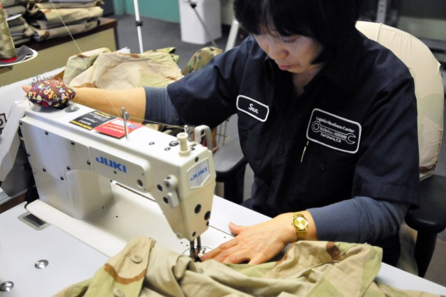 Part of the Central Issue Facility's mission is sewing and cloth repair for tenant units. (Photo by Jon Micheal Connor, ASC Public Affairs)