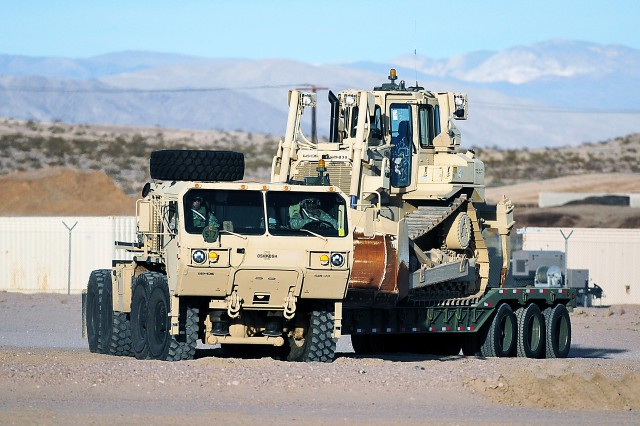 "Soldiers from a Brigade Combat Team, Joint Base Lewis-McChord, Washington, prepare their vehicles before going in the ""box"" at the National Training Center at Fort Irwin, California. One of the LRC-Irwin's main missions is to support the 10 scheduled rotations there. (Photo by Jon Micheal Connor, ASC Public Affairs)"