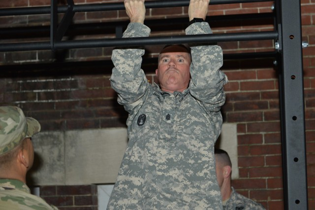 Command Sgt. Maj. Paul E. Biggs, senior enlisted advisor, Military District of Washington, completes a final set of 10 Chin-ups, giving his squad the required 150 before moving on to the next event, during 1st Battalion's, Squad PT Competition on Joint Base Myer-Henderson Hall.