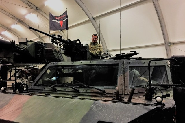 Lt. Col. Douglas Chimenti, commander, 3rd Battalion, 29th Field Artillery Regiment, 3rd Armored Brigade Combat Team, 4th Infantry Division, mans the main gun system atop a Dutch military Fennek Reconnaissance vehicle during the BISON 2017 training exercise at Drawsko Pomorskie, Poland, Jan. 31, 2017. As part of Atlantic Resolve, 3rd Bn., 29th FA Regt. is devising collective training with multinational partners that is designed to be stressful, challenging, and fast-paced. The goal is to strengthen NATO's ability to respond immediately to crises. (U.S. Army photo by Capt. Brett Tinder/3rd Armored Brigade Combat Team, 4th Infantry Division Public Affairs)