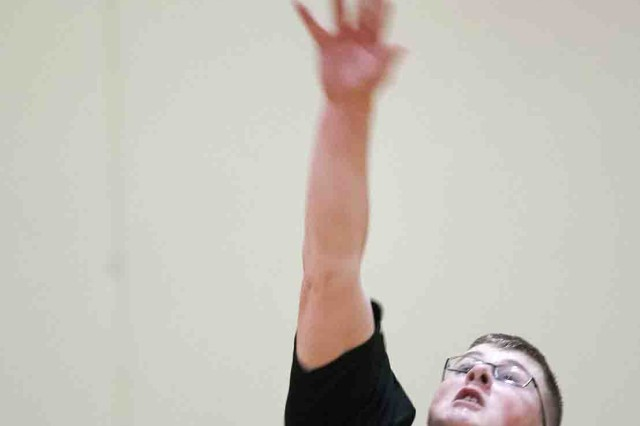 Jordan Christensen, Company D, 229th Military Intelligence Battalion, slaps a return during the first match of the Presidio of Monterey volleyball championship Jan. 30. Co. A won the title out of the loser's bracket in two matches, 25-12, 19-25, 15-6 and 24-13, 10-25, 15-13.