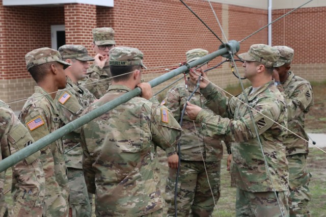 Sgt. Thomas Henry, a signal support systems specialist, with Bravo Troop, 6th Squadron, 8th Cavalry Regiment, 2nd Infantry Brigade Combat Team, 3rd Infantry Division, show Soldiers how to set an RF-1944 series broadband antenna, January 18, 2017, at Fort Stewart, Ga. 6-8 Cav. Soldiers received demonstrations and classes for different radio devices and equipment during a communication class. (U.S.Army photo by Sgt. John Onuoha / Released)