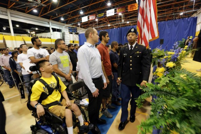 Cadet Jewell Jones with the color guard detail at a freshman invocation ceremony, University of Michigan-Dearborn.