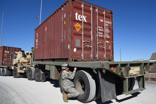 A truck driver from the Oklahoma Army National Guard's 1345th Transportation Company, 700th Brigade Support Battalion, prepares his trailer for offload at McAlester Army Ammunition Plant, Okla., Jan. 26. Oklahoma and Missouri Army National Guardsmen the War Reserve Stocks for Allies-Korea retrograde munitions from the Military Ocean Terminal Concord, Calif., as part of their annual training. The mission started in Norman, Okla., on Jan. 13 and concluded with the delivery to McAlester Army Ammunition Plant.