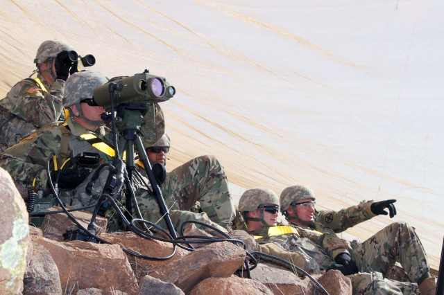 Fire support specialists, or forward observers, in Advanced Individual Training Class No. 05/06-17 watch as field artillery rounds which they called for, hit targets at the base of Signal Mountain, Feb. 1, 2017, at Fort Sill's Observation Post Andrews.