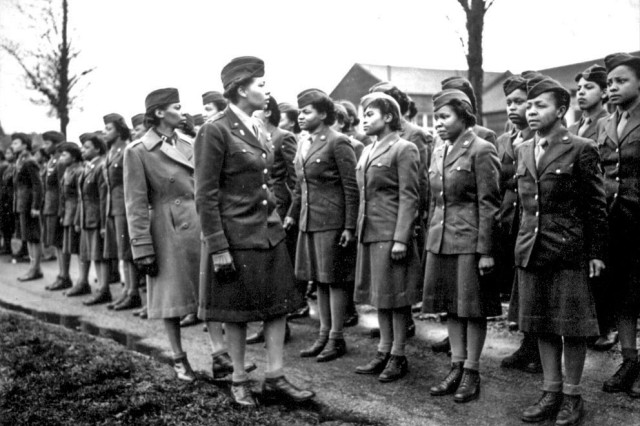 Battalion Commander Maj. Charity Adams and Executive Officer Capt. Abbie Noel Campbell inspect the first Soldiers of the 6888th Central Postal Directory Battalion to arrive in England, February 15, 1945. The only African-American Women's Army Corps unit sent to Europe during World War II, the 6888th was responsible for clearing years' worth of backlogged mail in both England and France. Viewing their jobs as crucial to morale at the front, they processed some 65,000 pieces of mail a shift and worked three shifts a day. At the same time, the Soldiers faced constant prejudice and broke gender and racial barriers.