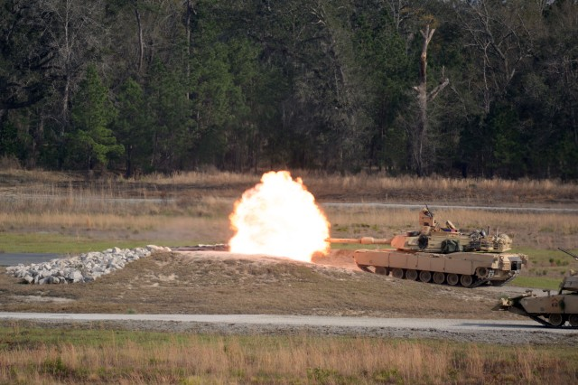A M1A2 Abrams Main Battle Tank from 1st Battalion, 64th Armor Regiment engages a target during the company's Combined Arms Live-Fire Exercise at Fort Stewart, Georgia Feb. 4, 2017.