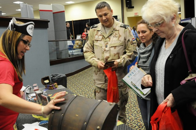 People browse a booth and peak into a treasure chest of prizes during last year's Travel Extravaganza. This year's event is scheduled for Feb. 22 from 10 a.m. until 1 p.m. at The Landing.