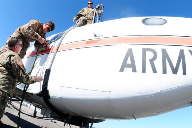 Soldiers of the 3rd Infantry Division out of Savannah, Georgia, prepare and rig a C-12, to be sling loaded from Dothan Airport to Fort Rucker's Aviation Combat Forensics Lab Jan. 31.