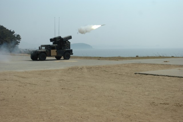 Soldiers from E Battery, 6th Battalion, 52nd Air Defense Artillery, attached to 6th Battalion, 37th Field Artillery Regiment, 210th Fires Brigade, 2nd Infantry Division, fire stinger missiles from the M-1097 Avenger Air Defense System during qualification exercises in Daecheon, South Korea, April 4, 2013. Their mission was to qualify crews to enhance the unit's readiness to fight tonight to deter aggression against South Korea. (U. S. Army photo by Staff Sgt. Carlos R. Davis, 210th Fires Brigade Public Affairs NCO/Released)