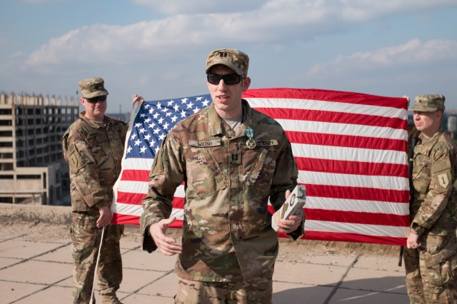Capt. David Webb, operations officer, Headquarters and Headquarters Battalion, 1st Infantry Division, Combined Joint Forces Land Component Command -- Operations Inherent Resolve, speaks to his fellow Soldiers after receiving the Joint Service Commendation Medal Jan. 22 in Baghdad, Iraq. The medal is an end of tour award and Webb's tour ended early as he heads to the Special Forces Assessment and Selection on March 1 in Fort Bragg, North Carolina. Webb was notified three months prior to this deployment that he would attend SFAS. (Spc. Derrik Tribbey, CJFLCC-OIR Public Affairs)