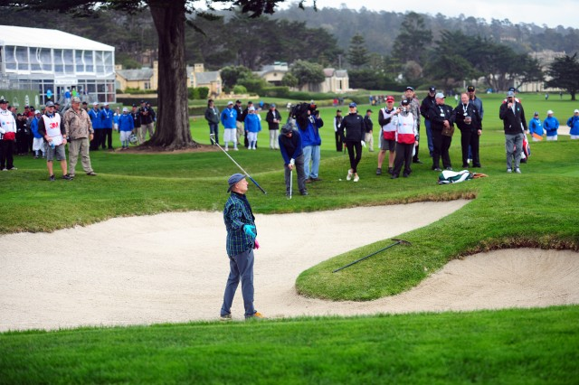 PRESIDIO OF MONTEREY, Calif. -- Actor Bill Murray tosses his golf club after hitting out of the bunker at Pebble Beach's 18th green during the 3-M Celebrity Challenge charity event, Feb. 8.