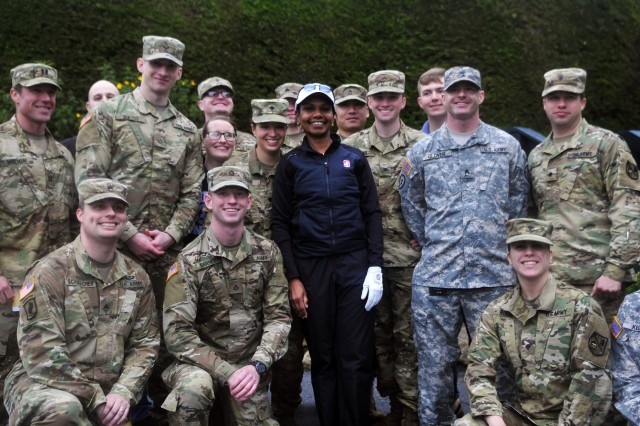PRESIDIO OF MONTEREY, Calif. -- Former Secretary of State Condoleeza Rice poses for a photo with Soldiers from the 229th Military Intelligence Battalion after the 3-M Celebrity Challenge charity event at Pebble Beach, Feb. 8.