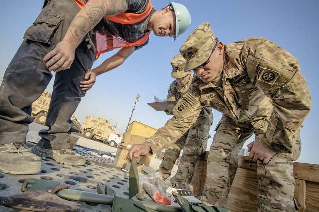 Staff Sgt. Jose Rios (right), 1st Squadron, 73rd Cavalry Regiment, 2nd Brigade Combat Team, 82nd Airborne Division verifies inventory with the help of a Vectrus contractor during an equipment layout led by the 401st Army Field Support Brigade at Camp Arifjan, Kuwait, Feb. 6. (U.S. Army photo by Justin Graff, 401st AFSB Public Affairs)