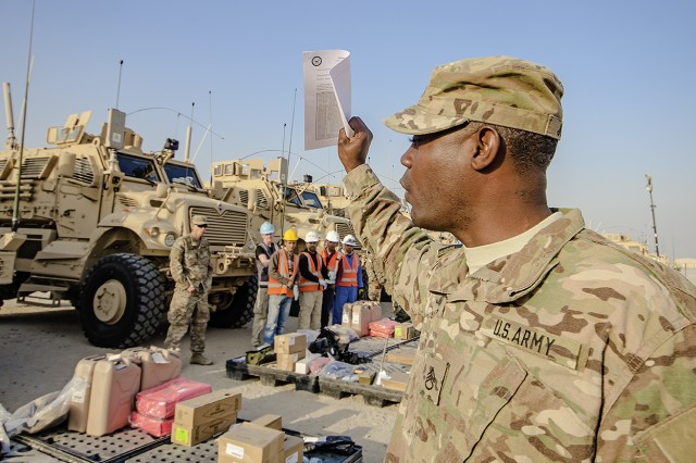 Staff Sgt. Willie Jones, 37th Brigade Engineer battalion, 2nd Brigade Combat Team, 82nd Airborne Division verifies inventory during an equipment layout led by the 401st Army Field Support Brigade at Camp Arifjan, Kuwait, Feb. 6. (U.S. Army photo by Justin Graff, 401st AFSB Public Affairs)