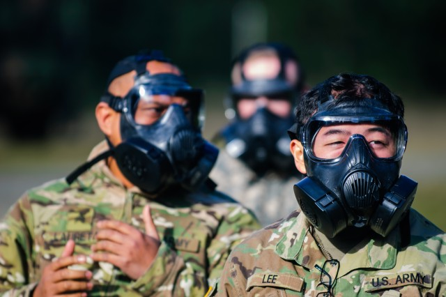 Soldiers from Headquarters and Headquarters Company, 301st Maneuver Enhancement Brigade, prepare to enter a mask confidence chamber as preparation for a response to a Chemical, Biological, Radiological or Nuclear (CBRN) attack, at Joint Base Lewis-McChord, Washington, January 21st, 2017. The purpose of the training was to familiarize soldiers with the M50 Joint Service General Purpose Mask, and to ensure that they are prepared to respond to a CBRN incident or attack (U.S. Army Reserve Photo by Spc. Sean Harding/Released).