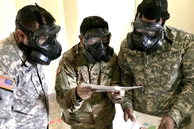 Soldiers from Headquarters and Headquarters Company, 301st Maneuver Enhancement Brigade, read a series of phrases to ensure the fit and breathability of the M50 Joint Service General Purpose Mask at Joint Base Lewis-McChord, Washington, January 21, 2017. The purpose of the training was to familiarize soldiers with the M50 Joint Service General Purpose Mask, and to ensure that they are prepared to respond to a CBRN incident or attack (U.S. Army Reserve Photo by Spc. Sean Harding/Released).