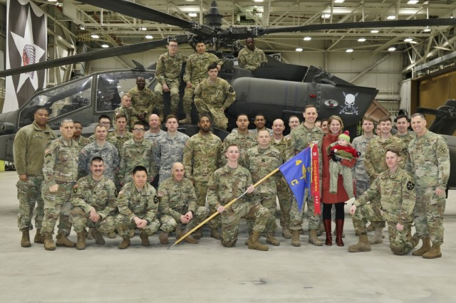 Soldiers assigned to Charlie Company, 4th Attack Reconnaissance Battalion, 2nd Aviation Regiment pose for a picture with Eighth Army Commanding General, Lt. Gen. Thomas S. Vandal and Eighth Army Senior Enlisted Advisor, Command Sgt. Maj. Richard E. Merritt at the conclusion of an Eighth Army Readiness Streamer ceremony at Camp Humphreys, Pyeongtaek, South Korea, Feb. 9. During the event, Vandal recognized Charlie Company for maintaining high levels of physical, mental and tactical readiness in the last 180 days.