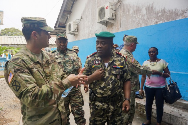 U.S. Army Maj. Aaron Smith, Office of Security Cooperation U.S. Embassy Yaoundé, discusses improvements to the hospital with Cameroonian Col. Abeng Mbozo'o, the chief of the Region 2 Military Clinic, during a visit to the Hopital Militaire de Douala, Feb. 8, 2017. The hospital has received support from both the U.S. military and nongovernmental organizations and serves the entire military and civilian community of Douala.