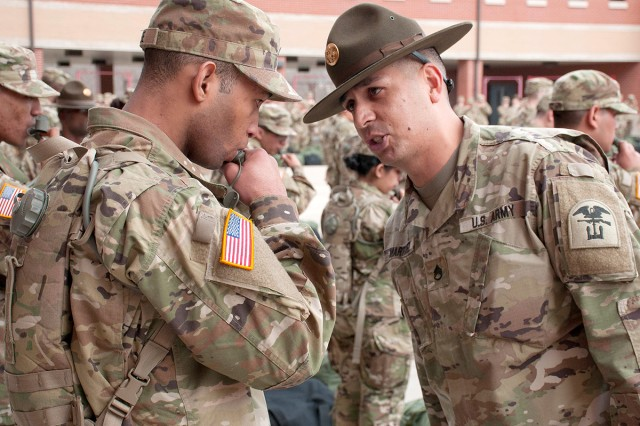 Staff Sgt. Jerome Martinez, Company D, 31st Engineer Battalion drill sergeant, questions a Soldier's actions during reception and integration.