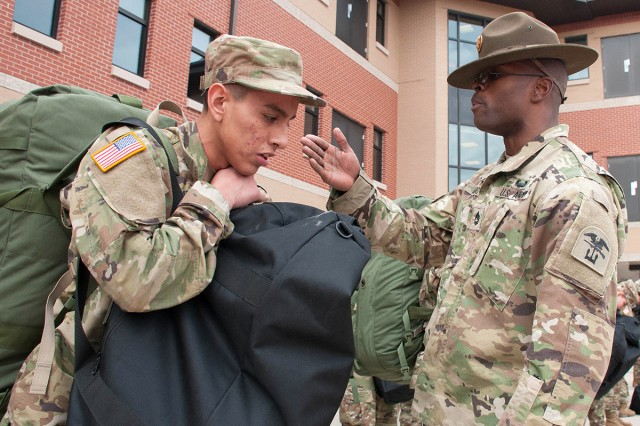 Sgt. 1st Class Andre Evans, drill sergeant with Company D, 31st Engineer Battalion, provides motivation to a new Soldier on his first day of training.