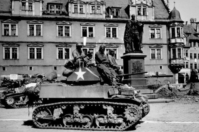 Tank crews from the 761st Tank Battalion await orders to clean out scattered Nazi machine gun nests in Coburg, Germany, April 25, 1945. The 761st Tank Battalion was the first African-American tank battalion to go into battle, and spent 183 continuous days in combat. The unit earned four campaign medals, 11 Silver Stars, 69 Bronze Stars and about 300 Purple Hearts. A Medal of Honor and a Presidential Unit Citation came later.