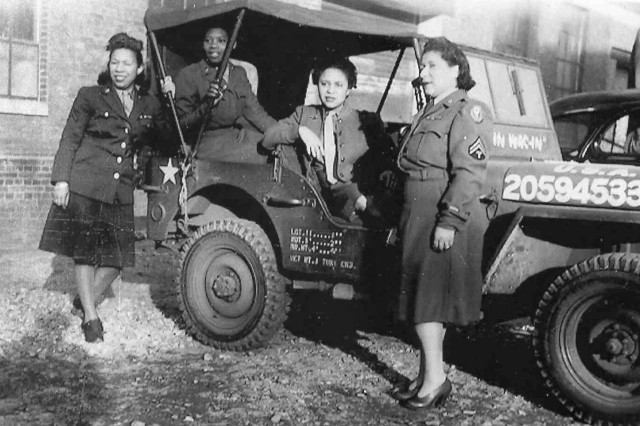 Cpl. Alyce Dixon (right) poses with other members of the 6888th Central Postal Directory Battalion during World War II. The only African-American Women's Army Corps unit to serve in Europe during World War II, the battalion was responsible for clearing a massive backlog of mail in first England and then France. Viewing their jobs as crucial to morale at the front, Soldiers processed some 65,000 pieces of mail per shift and worked three shifts a day. At the same time, they faced constant prejudice and broke gender and racial barriers.