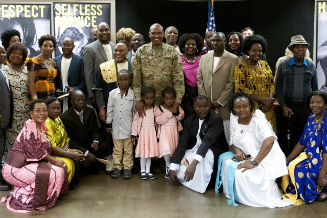 Maj. Frank Musisi, center, celebrates his promotion from captain to major with family and friends Oct. 14, 2016, at Joint Forces Training Base Los Alamitos, Calif. (U.S. Army Photo by Sgt. 1st Class Alexandra Hays, 79th Sustainment Support Command).
