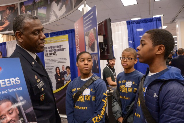 Maj. Gen. Cedric Wins, RDECOM commanding general, chats with high school visitors at the Army Materiel Command exhibit during the Black Engineer of the Year Awards Conference in Washington, D.C., Feb. 9-11.