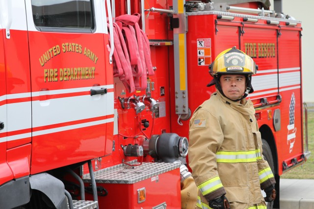 U.S. Army Garrison - Okinawa Firefighter Akira Kohama participates in a practice drill on Torii Station. Kohama says he is very proud to be a fireman and of his fire department for winning the Pacific Region Department of Defense Small Fire Department of the Year award for calendar year 2016.