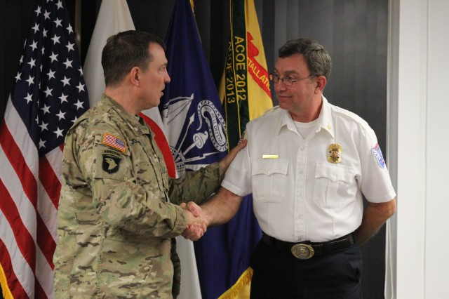 U.S. Army Garrison - Okinawa Fire Chief Butler receives recognition at Torii Station from Col. William B. Johnson, U.S. Army Garrison-Japan Commander, for receiving the Best Small Fire Department of the Pacific award.