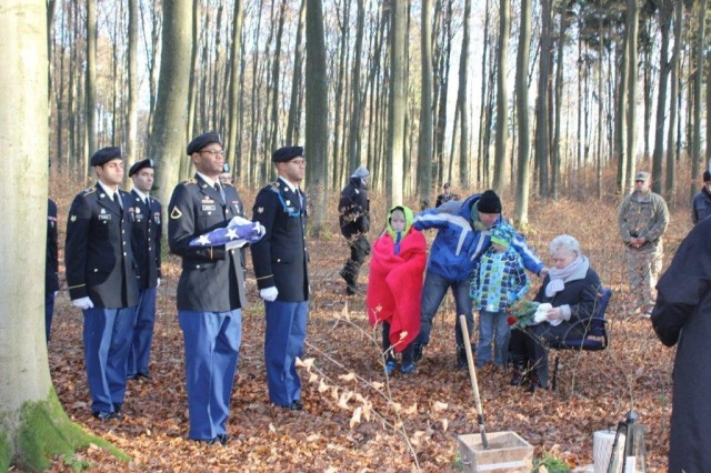 Soldiers render military funeral honors for an Army retiree during a ceremony with the surviving family members at a Ruheforst Cemetery in Laubach, Germany.