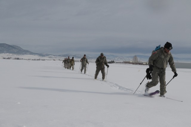 Soldiers assigned to the Battalion Support Company, 3rd Battalion, 10th Special Forces Group (Airborne) move across Marshall Drop zone during cross-country ski training at Fort Harrison, Montana Feb. 9, 2017. Soldiers honed their skills in a variety of cold weather activities from this ski movement training to snowmobile training to live fire sniper and automatic weapon ranges.