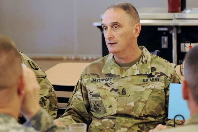 Command Sgt. Maj. David Davenport Sr., the Training and Doctrine Command's command sergeant major, discusses changes to Soldier training over lunch with leaders from the 1st Battalion, 209th Regiment (Regional Training Institute), on Sept. 29, 2016, at Camp Ashland, Nebraska.